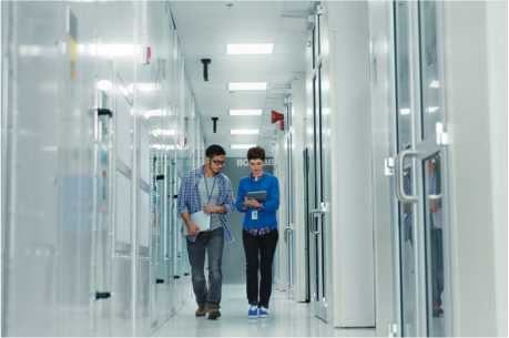 Two-People-Walking-In-A-Data-Center.png