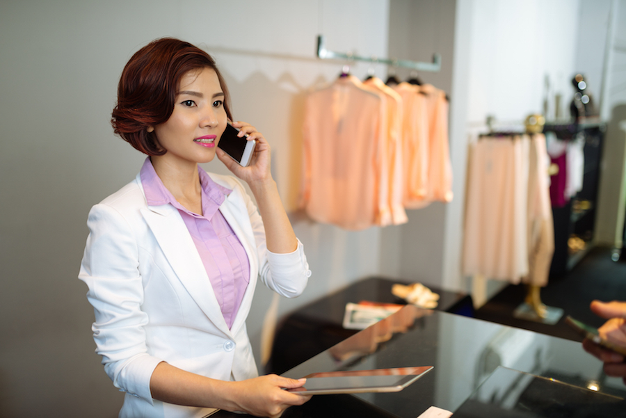 Woman-talking-on-phone-and-using-tablet-in-retail.jpg