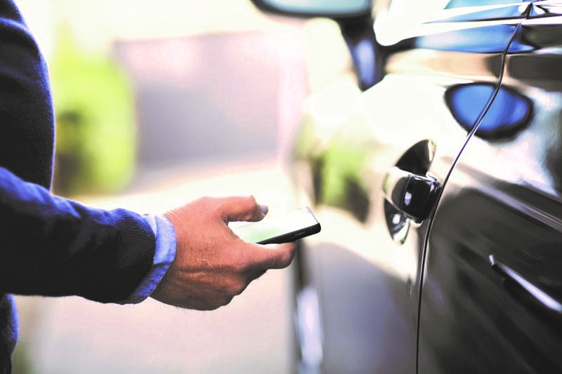 man-using-mobile-device-by-his-car.jpg