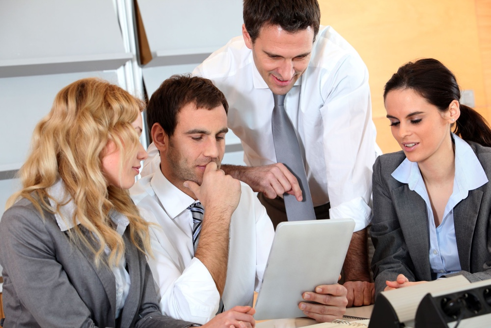 business-people-looking-tablet.jpg