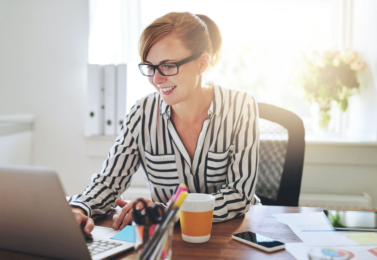 45116784 - successful female entrepreneur with a new online business working from home on her computer typing in data
