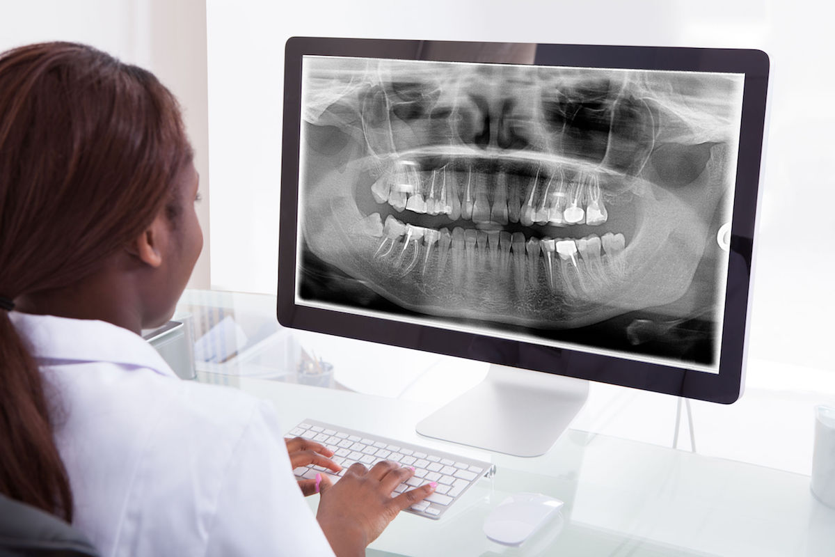 female dentist computer xray
