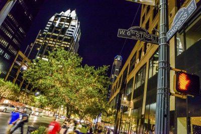 Austin TX downtown cityscape city life night, 6th Street.