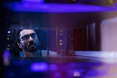 data center manager inside server rack