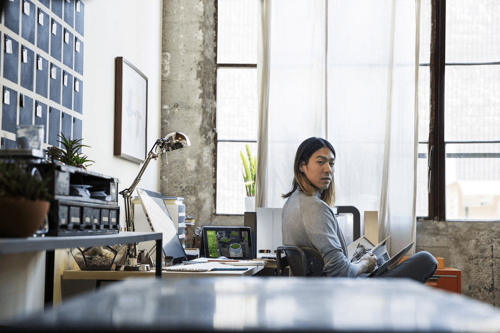 Employee at desk using workplace technology