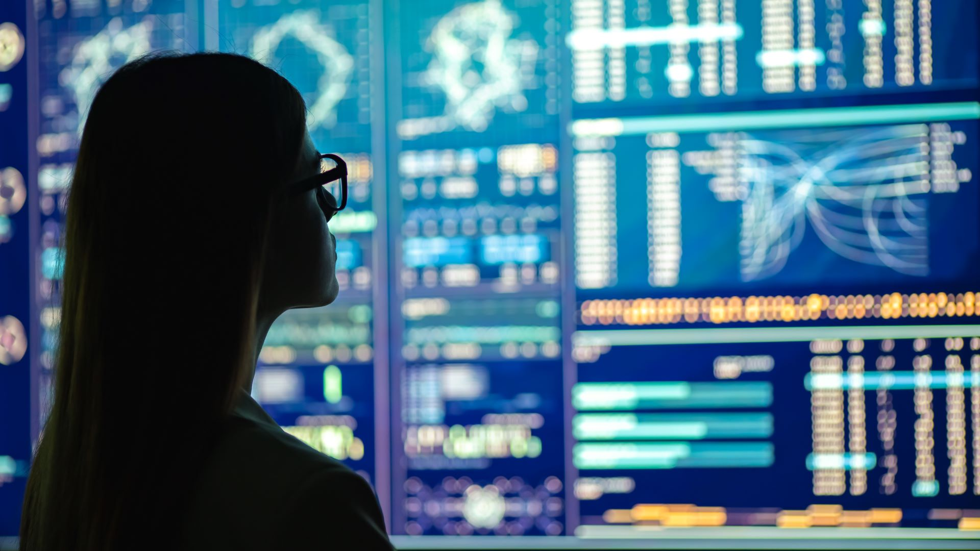 Photo of a person looking at a cloud computing dashboard representing VMC on AWS