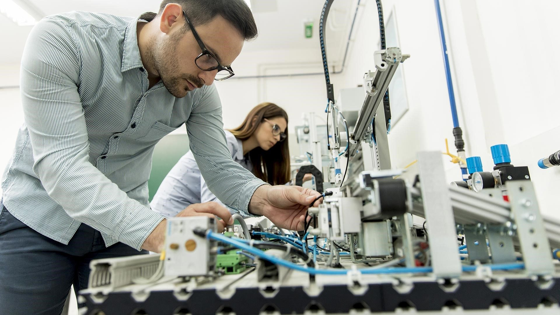 Two scientists working in a robotics lab