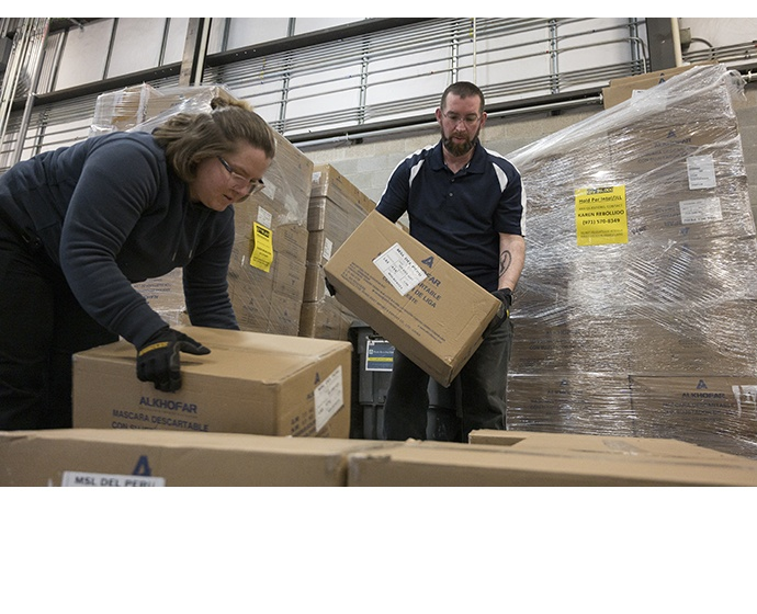 Ashly Yates (left) and Ryan Canney pack boxes of 20,000 Intel-do