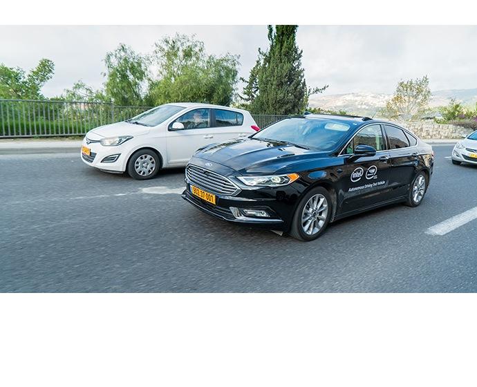 A Mobileye autonomous vehicle maneuvers through traffic in Jerus