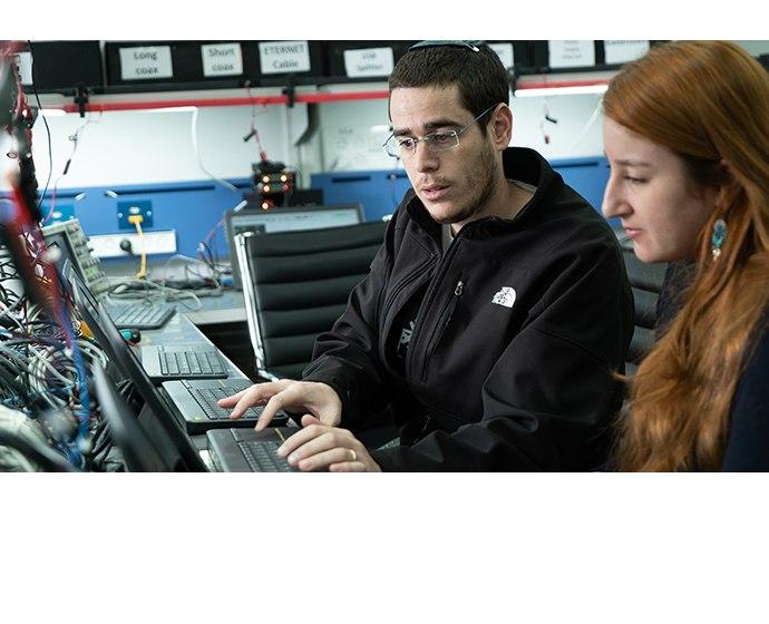 Mobileye employees work in a company lab in Jerusalem in Decembe