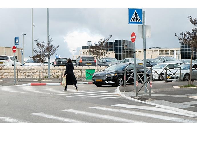 A pedestrian crosses in front of Mobileye's autonomous vehicle
