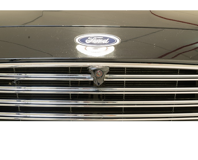 A photo shows a Mobileye front bumper low camera at a company wo