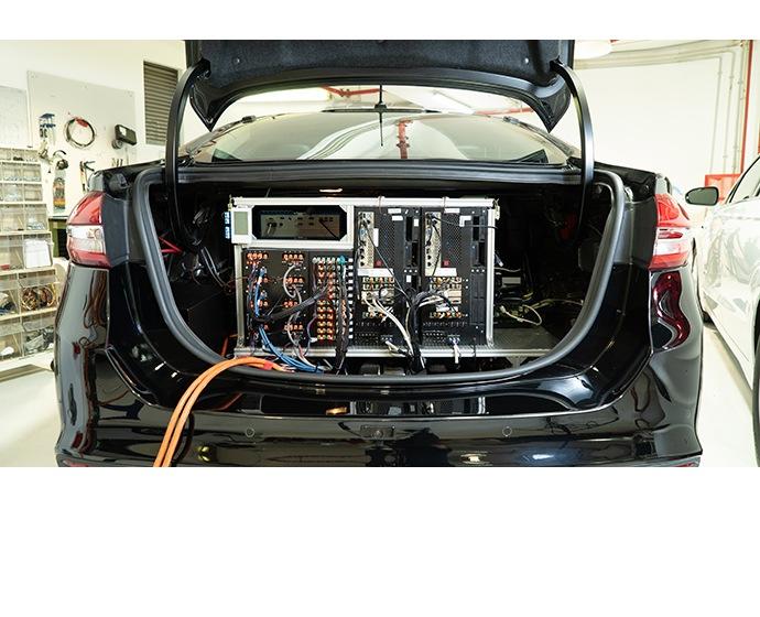 A photo shows the trunk of a Mobileye autonomous car at a compan