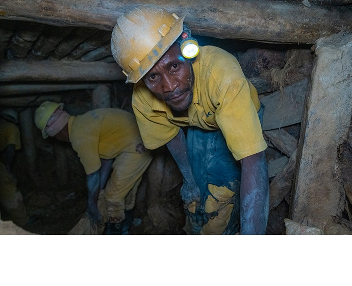 A worker inside a tin mine run by the Comikagi cooperative, near