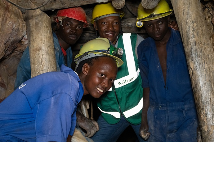 Workers inside the Wolfram Mining and Processing mine at Rwinkwa