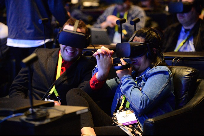 Audience members react to a virtual reality experience as Brian Krzanich, Intel chief executive officers, speaks at a company news conference on Wednesday, Jan. 4, 2017, in Las Vegas. Intel Corporation presents new technology at the 2017 International Consumer Electronics Show. The event runs from Jan. 5 to Jan. 8, 2017, in Las Vegas. (CREDIT: Walden Kirsch/Intel Corporation)