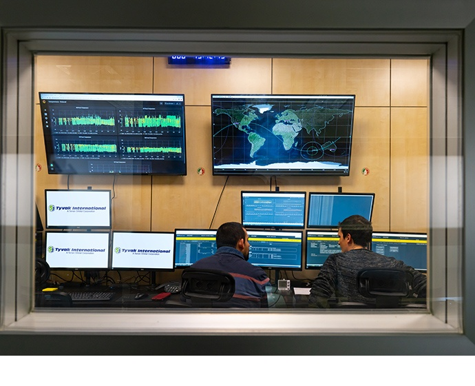 Employees in the operations center at Tyvak International in Tur