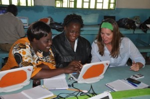 Intel employee, Cindi Wiggin (right), giving personal instruction to two Matete teachers, Beatrice Akosa (middle) and Anne Iminza (left).