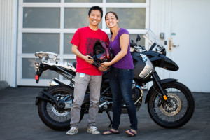 Xiaochao Yang (left) and Stephanie Moyerman with the modified HJC helmet and BMW R1200 GS motorcycle.