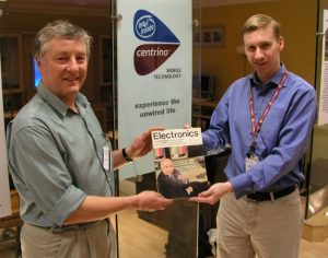 David Clark (left) delivers his copy of Electronics magazine to Intel's Nick Knupffer in Swindon. (2005) Photo: HEXUS.net
