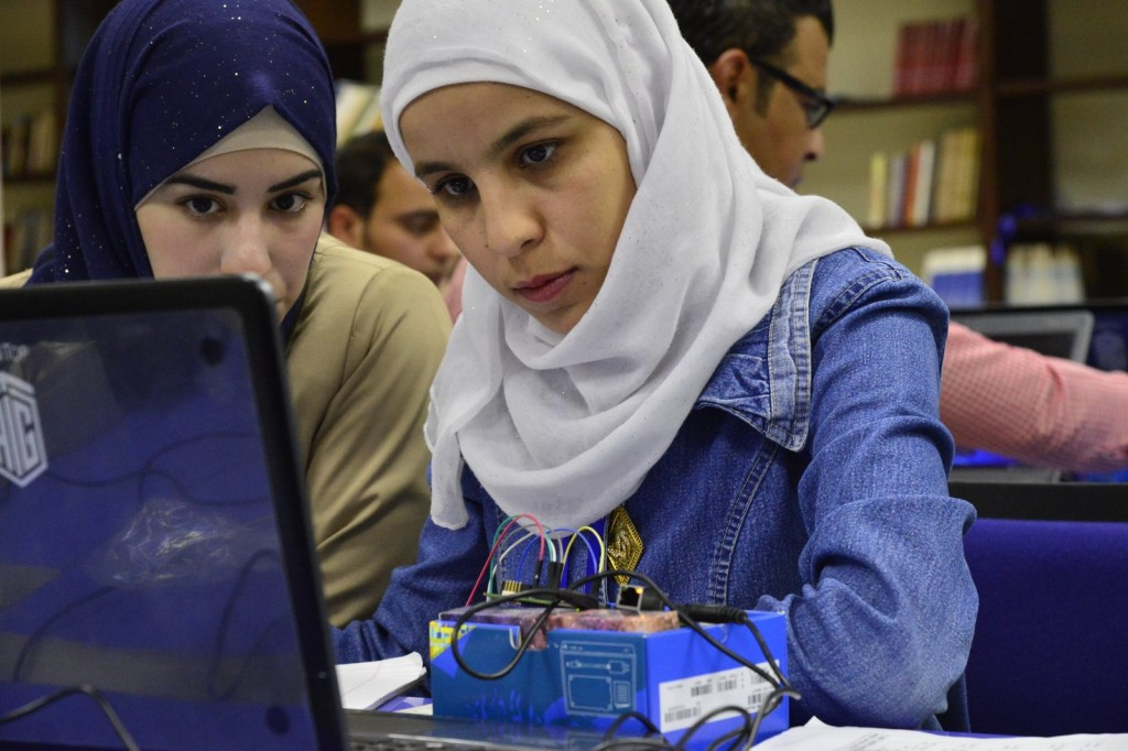 Computer engineering graduates Arwa Tarawneh (left) and Suha Habashneh are learning how to work with Intel Galileo.