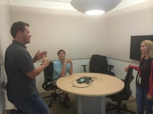 Adam Munder in a collaboration room with his interpreters.