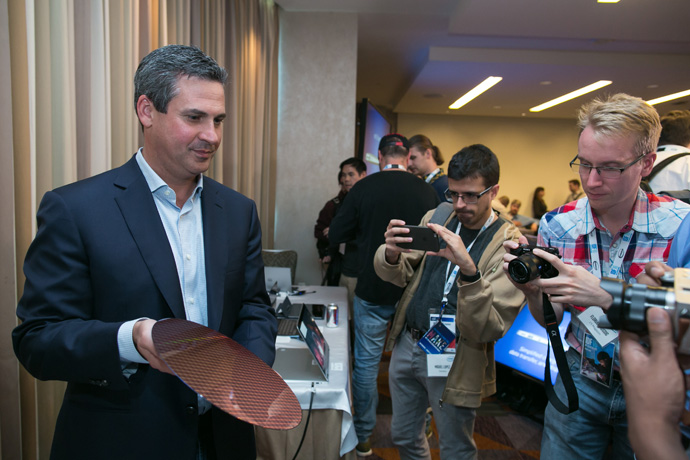 Chris Walker, Intel vice president for its Client Computing Group and general manager of notebook product marketing, displays a 7th Gen Intel Core processor silicon wafer. 7th Gen Intel Core processors deliver richer experiences, incredible performance and responsiveness, and true ultra HD 4K entertainment in stunning new devices. (Credit: Intel Corporation)