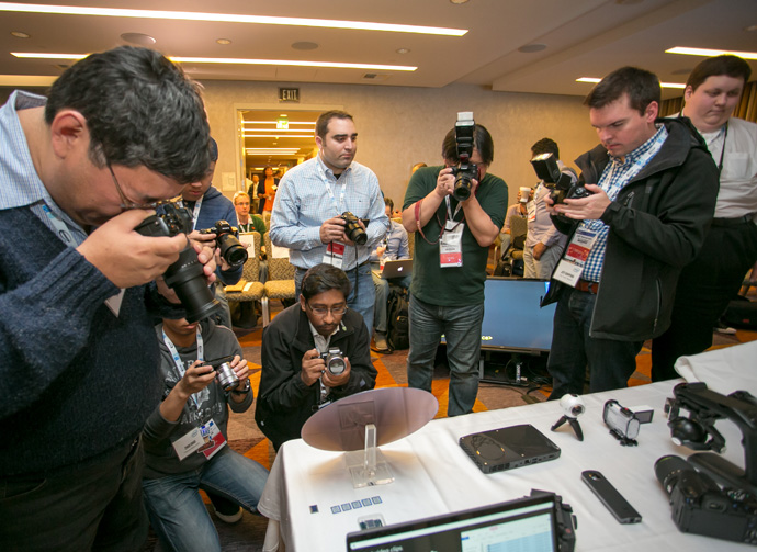 Photographers gather around a 7th Gen Intel Core processor silicon wafer. New 7th Gen Intel Core processors deliver richer experiences, incredible performance and responsiveness, and true ultra HD 4K entertainment in stunning new devices. (Credit: Intel Corporation)