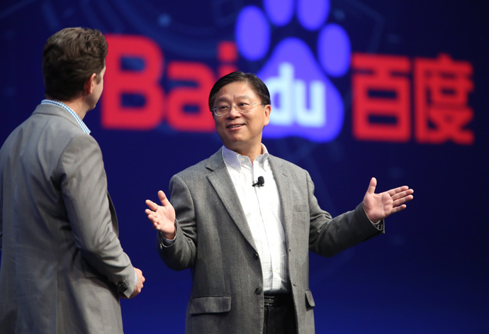 Jing Wang, senior vice president of Baidu and general manager of its autonomous driving unit, speaks with Intel's Doug Davis, senior vice president and general manager of the Internet of Things Group, during an investor event at the 2016 Intel Developer Forum in San Francisco on Thursday, Aug. 18, 2016. (Credit: Intel Corporation)