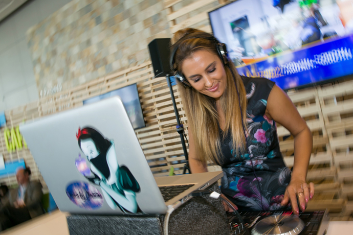 DJ Christina Flamer (AKA Sounds By Christina) provides background music for attendees at the 2016 Intel Developer Forum in San Francisco on Tuesday, Aug. 16, 2016. The robot uses Intel's Joule module. (Credit: Intel Corporation)