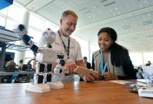 DJ Sures (left) with EZ-Robots talks with Intel's La Tiffaney Williams about robots that utilizes Intel's Joule module at the 2016 Intel Developer Forum in San Francisco on Tuesday, Aug. 16, 2016. (Credit: Intel Corporation)