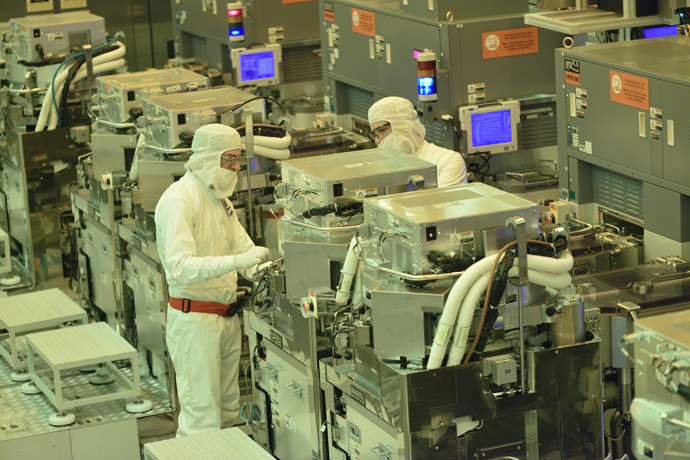 Intel Corporation's employees work in the D1X fabrication faci