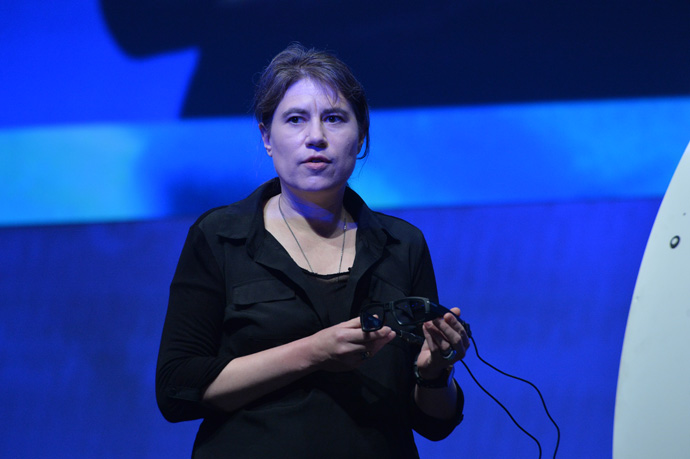 Intel's Diana Shea displays glasses that include the Joule maker board at the 2016 Intel Developer Forum in San Francisco on Tuesday, Aug. 16, 2016, during his opening keynote presentation. His presentation offered perspective on the unique role Intel will play as the boundaries of computing continue to expand. (Credit: Intel Corporation)