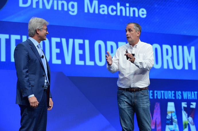 Intel Ceo Brian Krzanich welcomes Elmar Frickenstein, leader of BMW Group's autonomous driving, to the stage during his keynote at the 2016 Intel Developer Forum in San Francisco on Tuesday, Aug. 16, 2016. Frickenstein arrived on stage in an autonomous BMW i3. Intel, BMW Group and Mobileye are working together to help build a fully autonomous vehicle for the market by 2020. (Credit: Intel Corporation)
