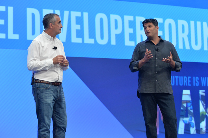 Intel CEO Brian Krzanich and Terry Myerson, Microsoft executive vice president, discuss new collaborations involving virtual reality software and hardware between Intel and Microsoft. Myerson joined Krzanich during his keynote at the 2016 Intel Developer Forum in San Francisco on Tuesday, Aug. 16, 2016. (Credit: Intel Corporation)