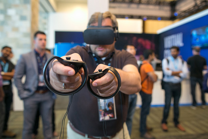 Uwe Erpel plays the virtual reality game Dead & Buried at the 2016 Intel Developer Forum in San Francisco on Tuesday, Aug. 16, 2016. (Credit: Intel Corporation)