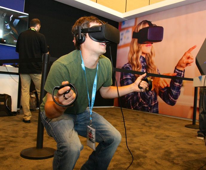 Matthew Imel, of Merx Consulting, participates in a virtual reality gunfight game that uses Intel Software Development Tools at the 2016 Intel Developer Forum in San Francisco on Wednesday, Aug. 17, 2016. (Credit: Intel Corporation)