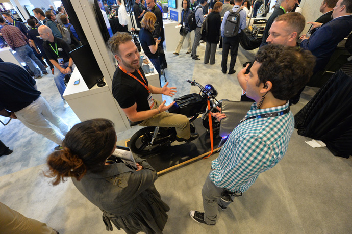 Josh Rasmussen with Bolt Motorbikes sits on one of the company's bikes at the Tech Showcase at the 2016 Intel Developer Forum in San Francisco on Tuesday, Aug. 16, 2016. Some of the Bolt machines are outfitted with Intel's Wind River and Edison technology. (Source: Intel Corporation)