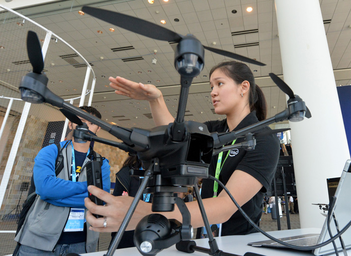 Intel's Madeleine Ong talks about the Yuneec drone and its ability to avoid obstacles during a demonstration at the 2016 Intel Developer Forum in San Francisco on Wednesday, Aug. 17, 2016. (Credit: Intel Corporation)