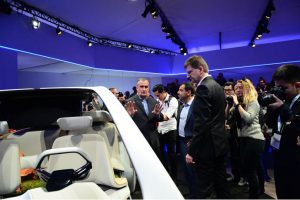 Intel CEO Brian Krzanich (from left), Mobileye co-founder Amnon Shashua and Klaus Fröhlich of BMW Group discuss a BMW prototype at the BMW Group news conference. The BMW Group, Intel, and Mobileye on Wednesday, Jan. 4, 2017, announced that a fleet of about 40 autonomous test vehicles will be tested on the roads by the second half of 2017.