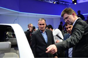 Intel CEO Brian Krzanich (from left), Mobileye co-founder Amnon Shashua and Klaus Fröhlich of BMW Group discuss a BMW prototype at the BMW Group news conference on Wednesday.