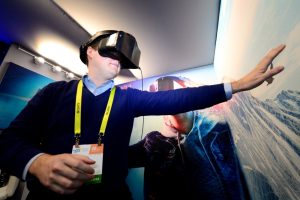A visitor to the Intel Corporation booth tries out a Project Alloy headset on Thursday.
