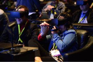 Audience members react to a virtual reality experience as Intel CEO Brian Krzanich speaks Wednesday.