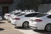 A row of Ford Fusion Hybrid data collection cars sit in the park