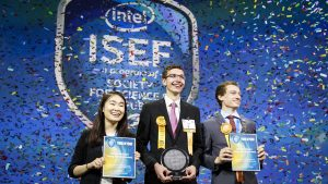 "Amber Yang (from left), Ivo Zell and Valerio Pagliarino take the stage on Friday, May 19, 2017, at the 2017 International Science and Engineering Fair, a program of Society for Science & the Public and the world's largest international pre-college science competition. Zell, of Lorch, Germany, was awarded first place for designing and constructing a remote control prototype of a new ""flying wing"" aircraft. Yang, of Windermere, Florida, and Pagliarino, of Castelnuovo Calcea, Italy, received Intel Foundation Young Scientist Awards. (Credit: Matt H. King)"