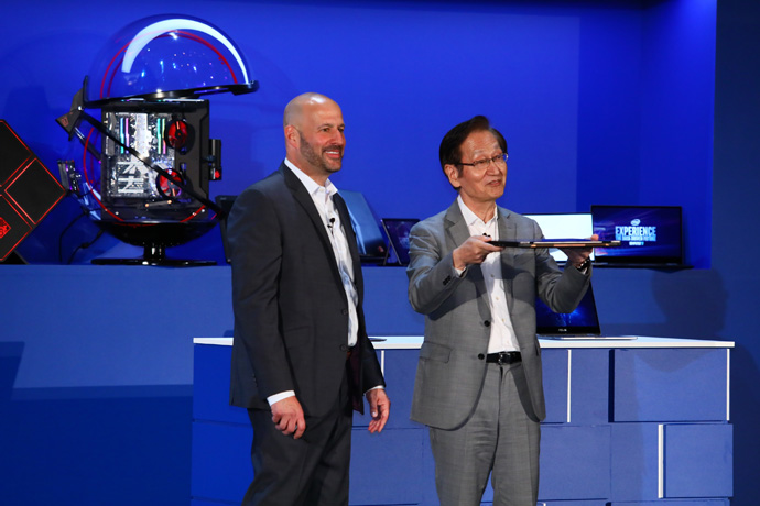 Intel's Gregory Bryant and ASUS Chairman Jonney Shih together sh