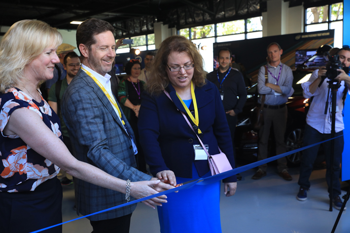 Intel's Kathy Winter (from left) Doug Davis and Patti Robb cut the entrance ribbon, officially opening Intel's Silicon Valley Center for Autonomous Driving in San Jose, California, to the public on Wednesday, May 3, 2017. (Credit: Intel Corporation)