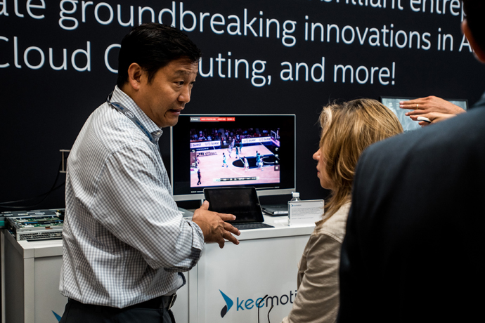 An attendee learns more about New Lab member company Keemotion a