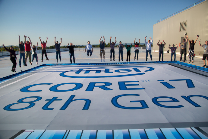 An Intel team celebrates at the unveiling of the 8th Gen Intel®