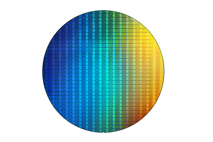 A photo show an 8th Gen Intel Core wafer. Intel announces the de